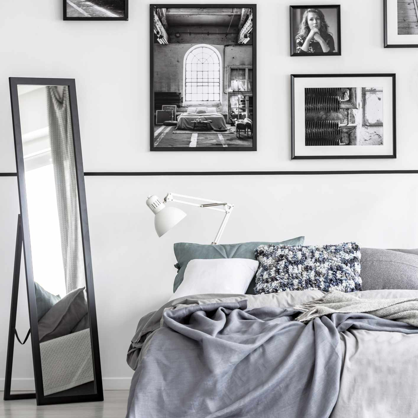 black and white gallery wall in bedroom