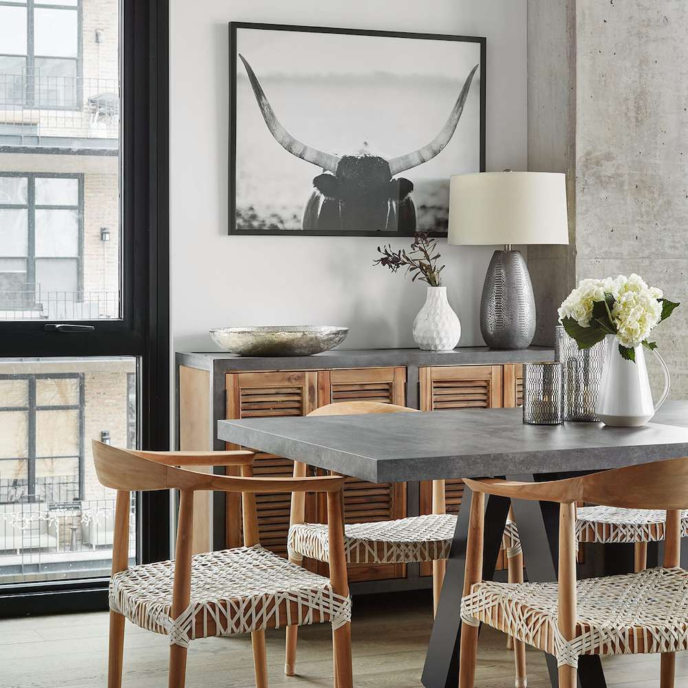 A dining room with slate rock and wood furniture