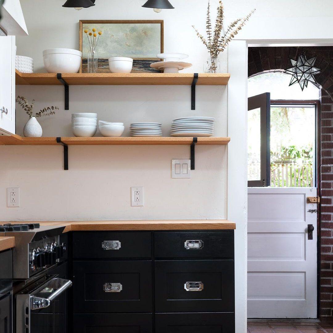Black cupboards in kitchen