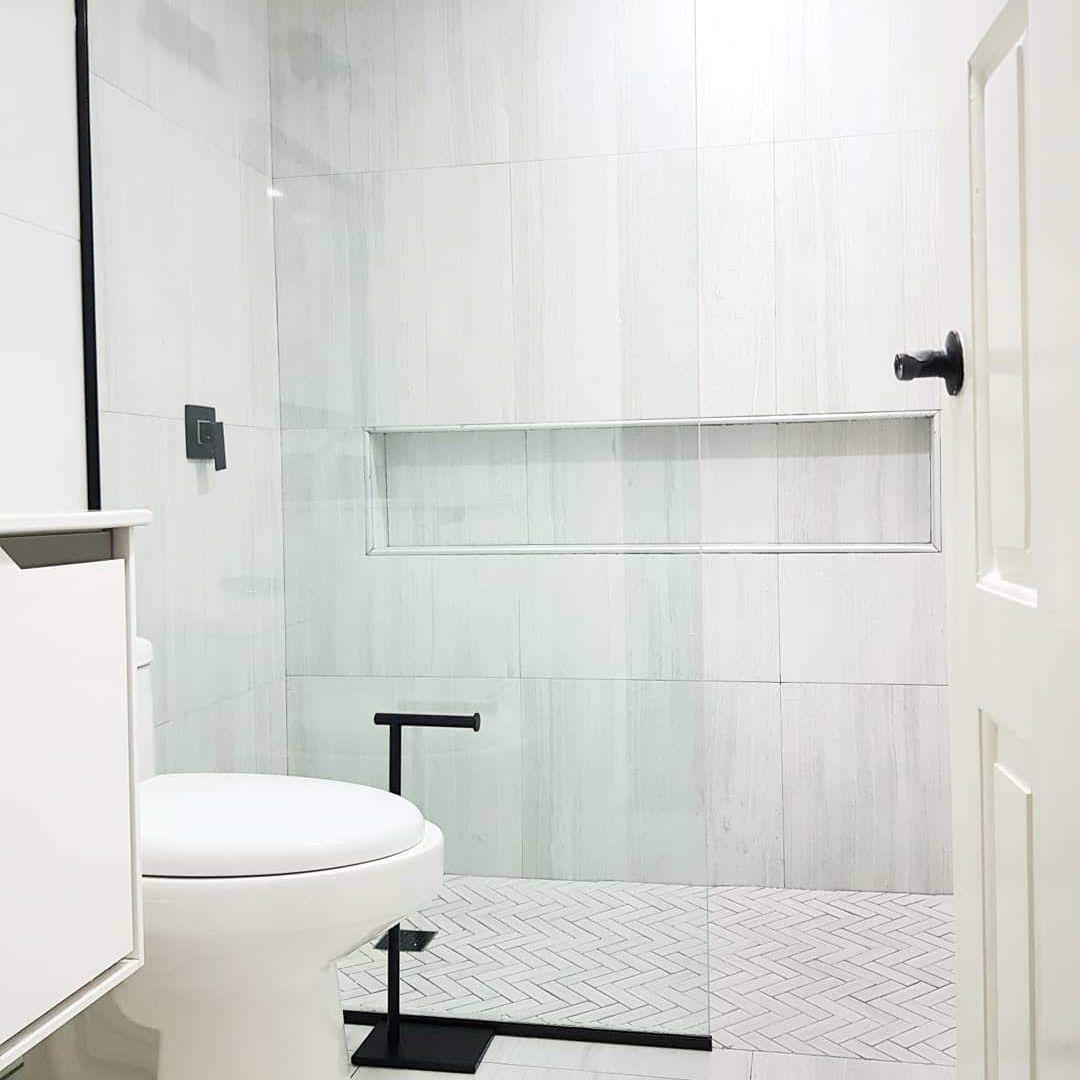 Tiled bathroom with chevron-patterned shower floor