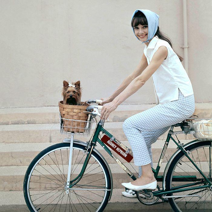Audrey Hepburn riding a bike