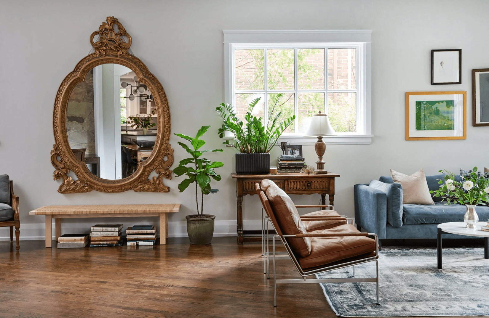 A living room with a large ornate mirror
