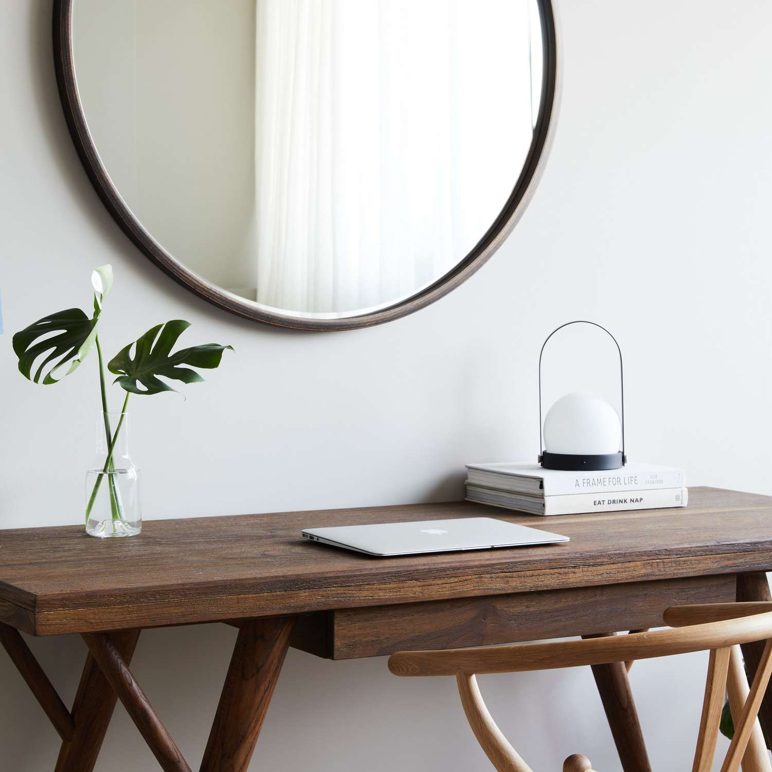 A midcentury modern desk decorated with minimal decor