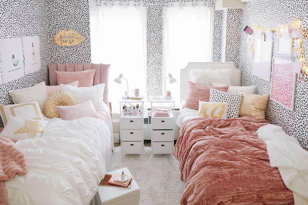 Dorm room lined with dotted wallpaper.
