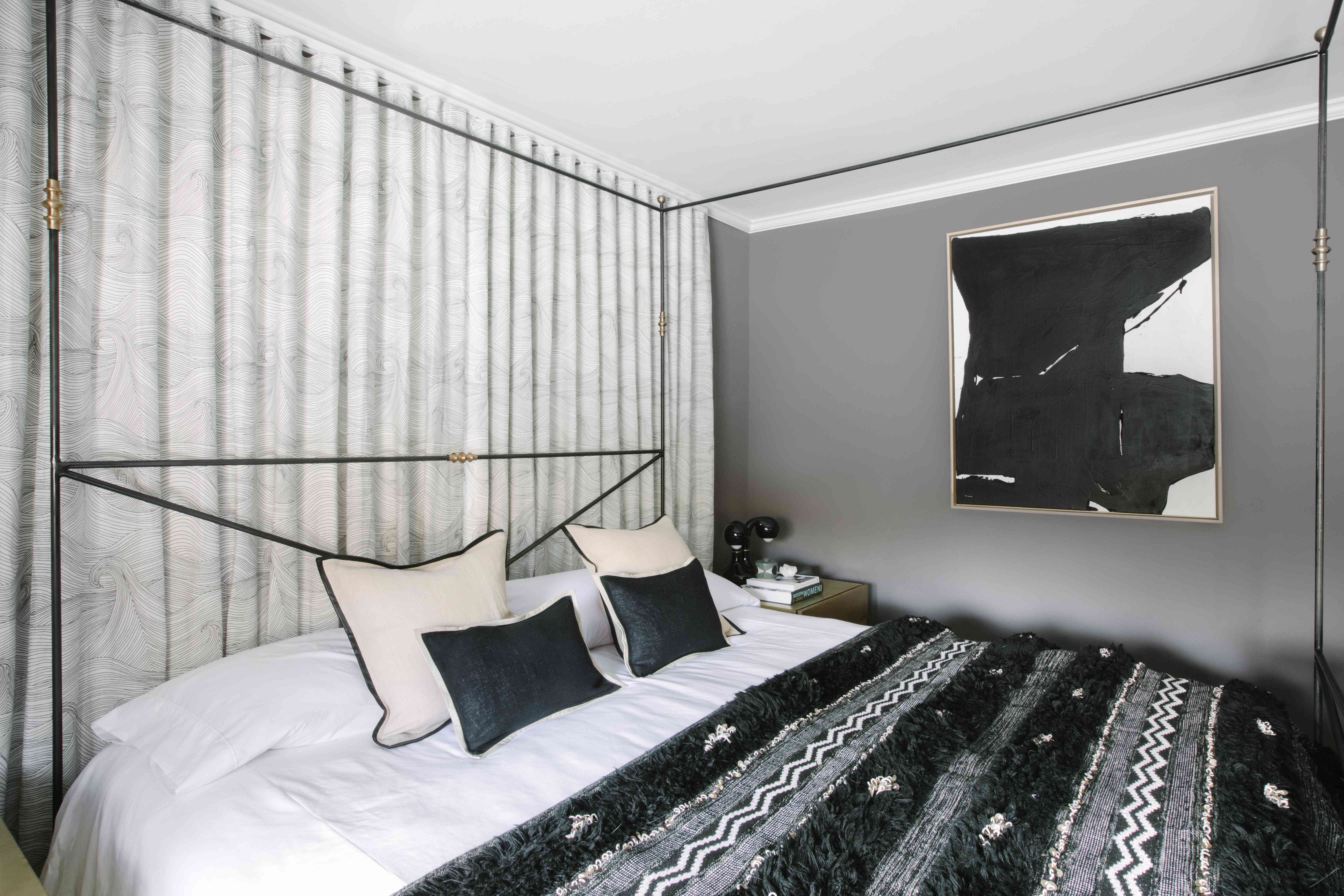 Gray bedroom with abstract art
