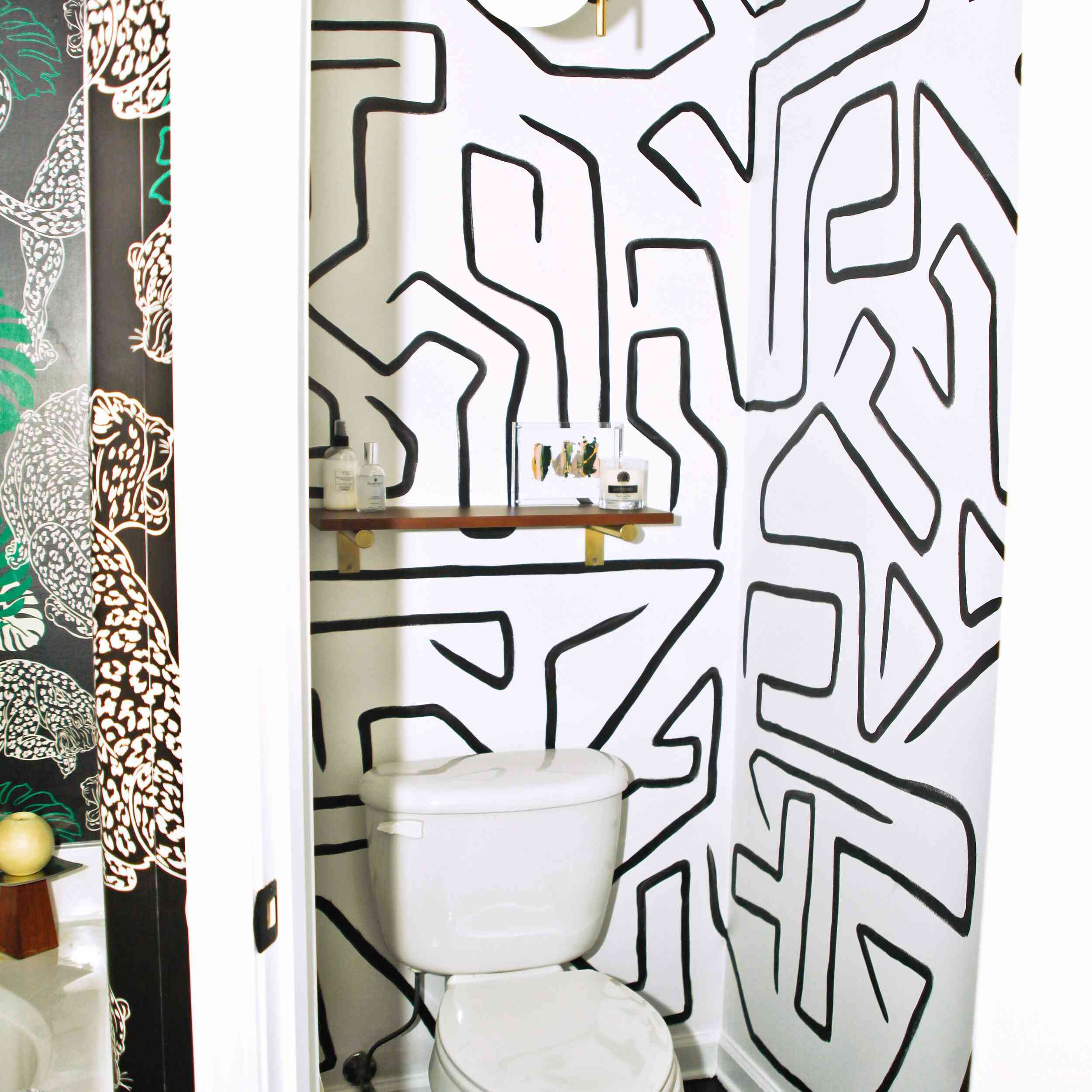 Hand-painted wallpapered powder room