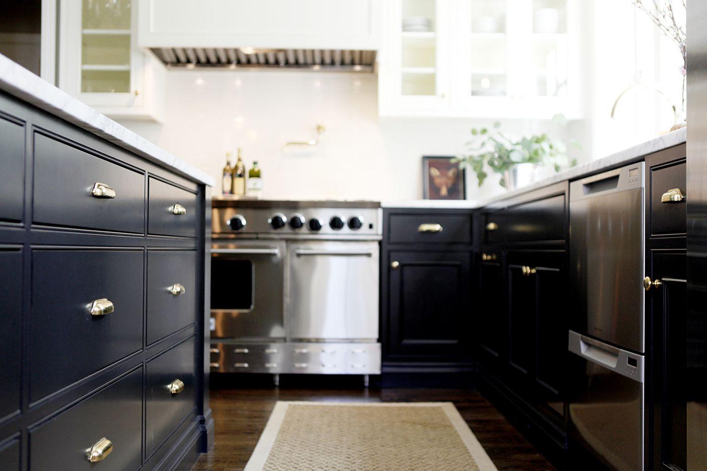 rattan kitchen rug in navy kitchen