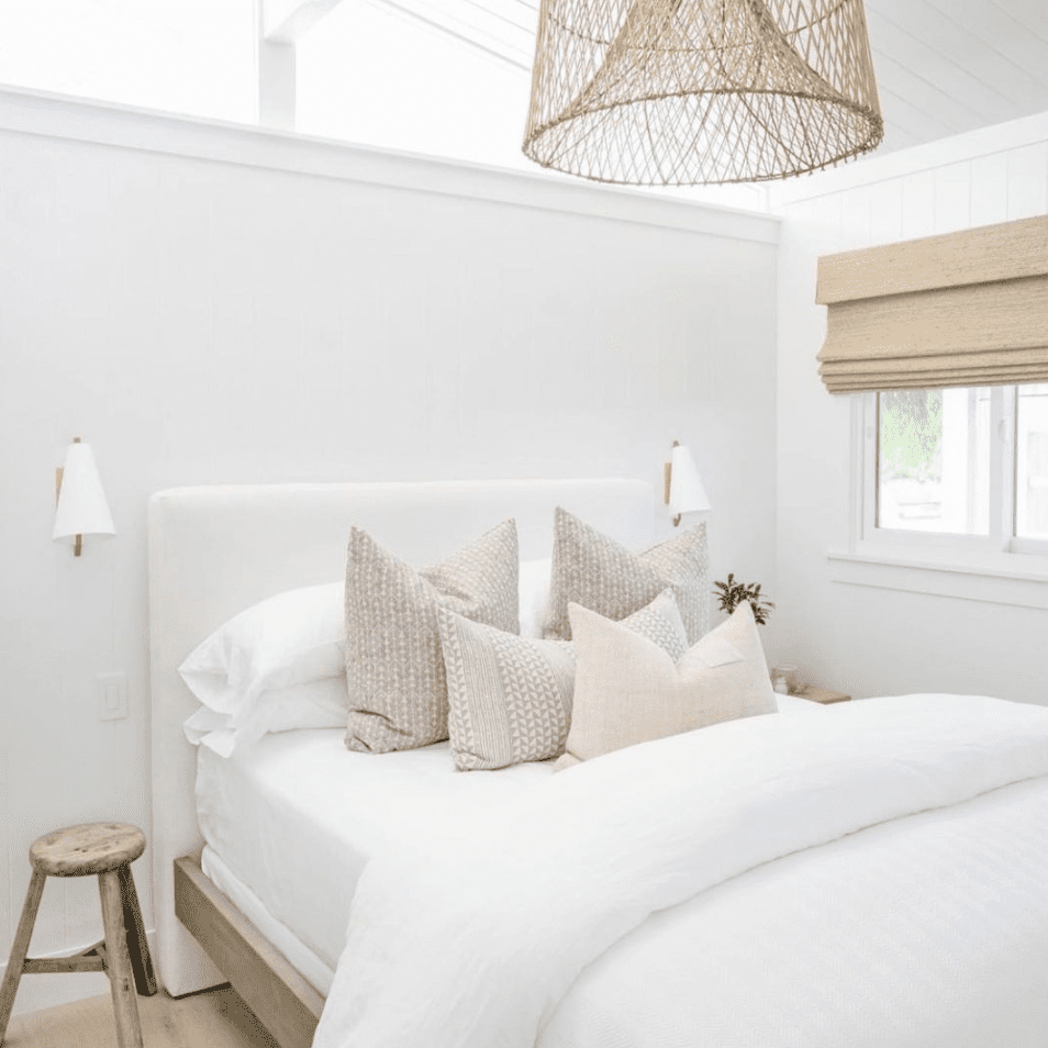 Clean bedroom with rattan lamp.