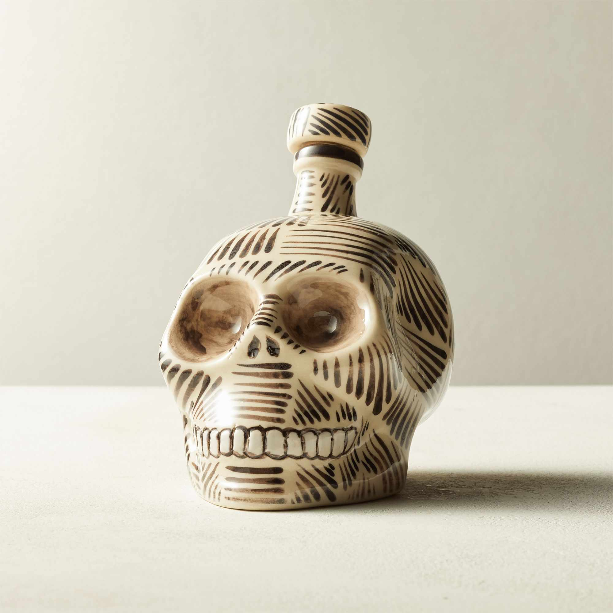 A Mexican skull-shaped tequila decanter by CB2.