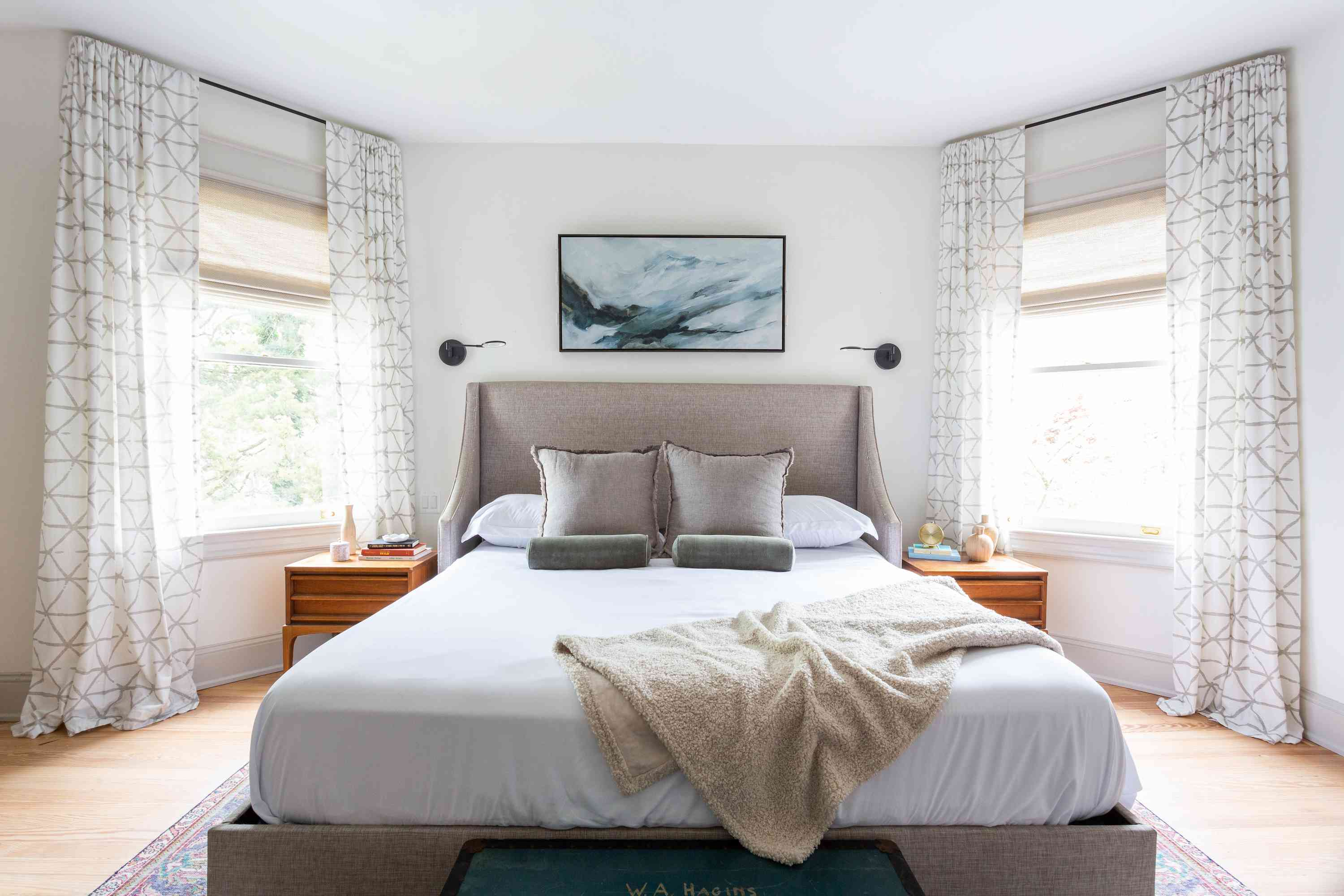Large primary bedroom with modern gray bedframe.