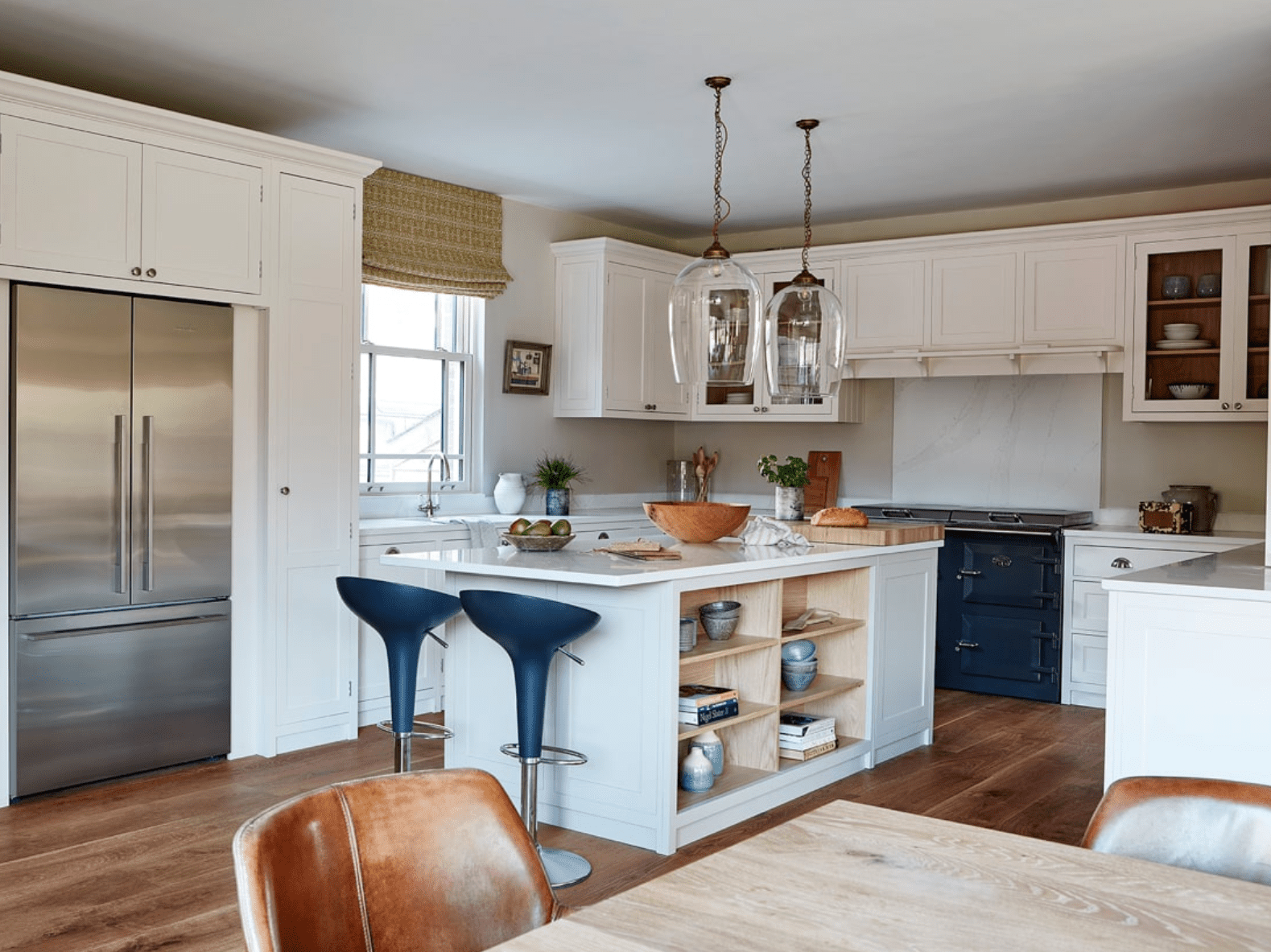 White kitchen with cobalt blue stove.