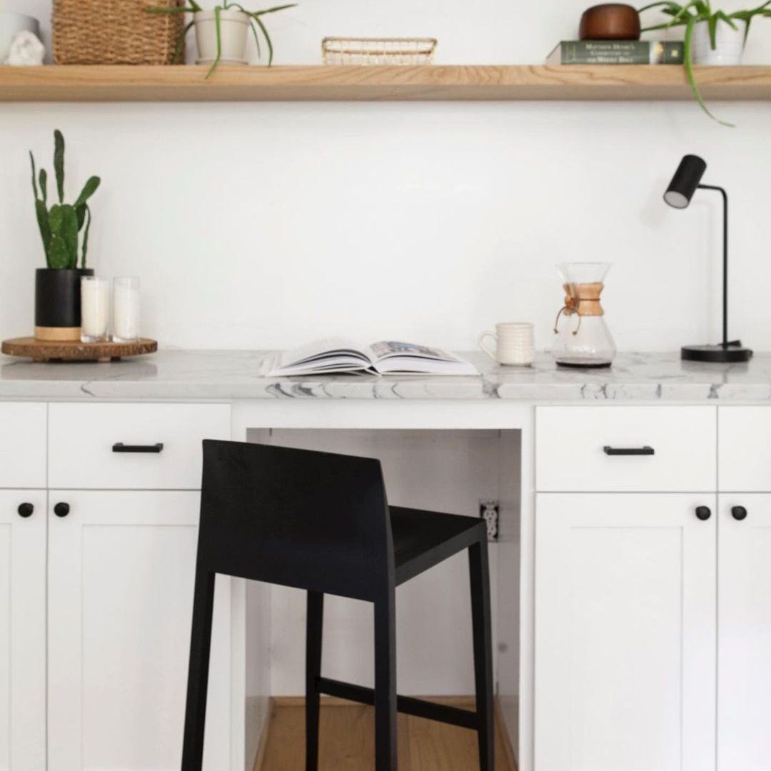 Office space with hanging shelves