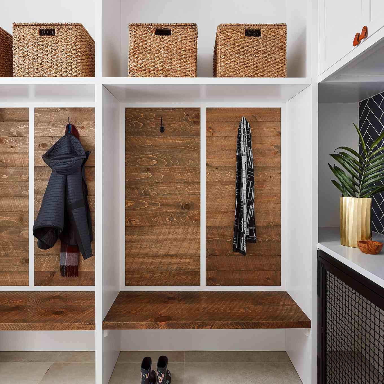 wood-lined mudroom cubbies