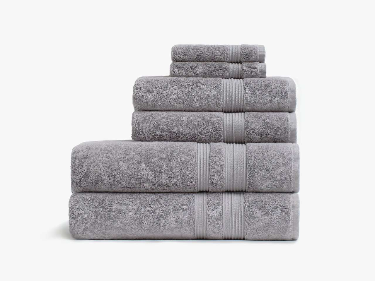 A pile of gray towels you can buy at Parachute