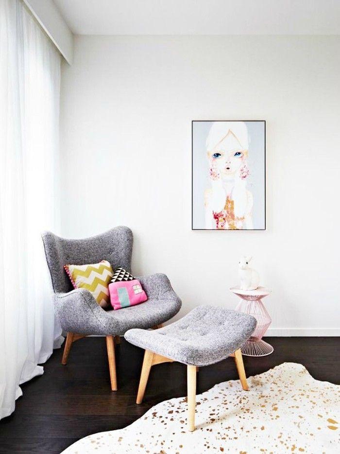 nursery with grey chair and ottoman