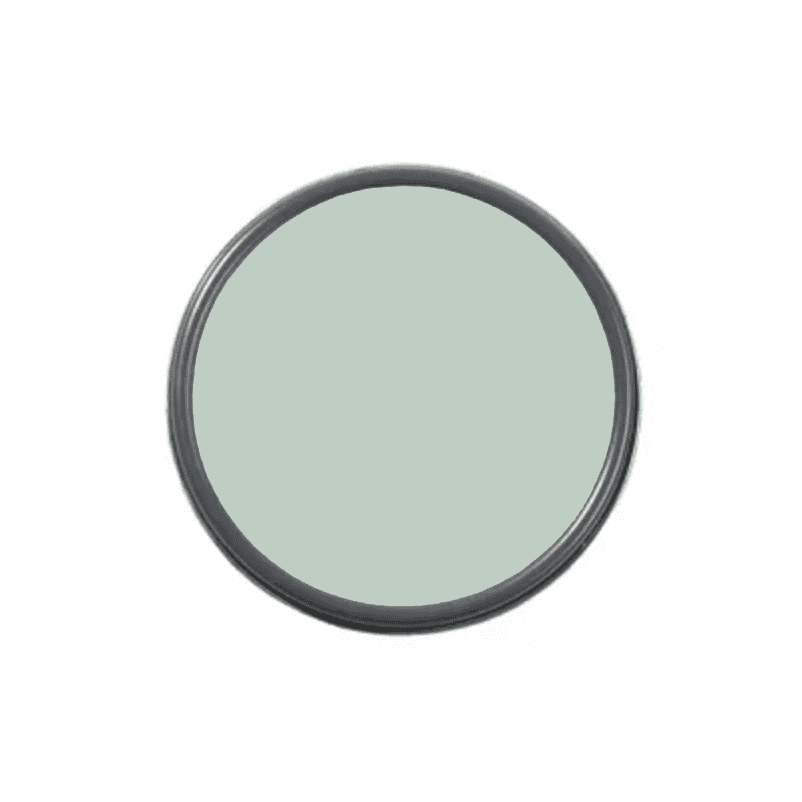 An overhead shot of a paint can with mint green paint in it