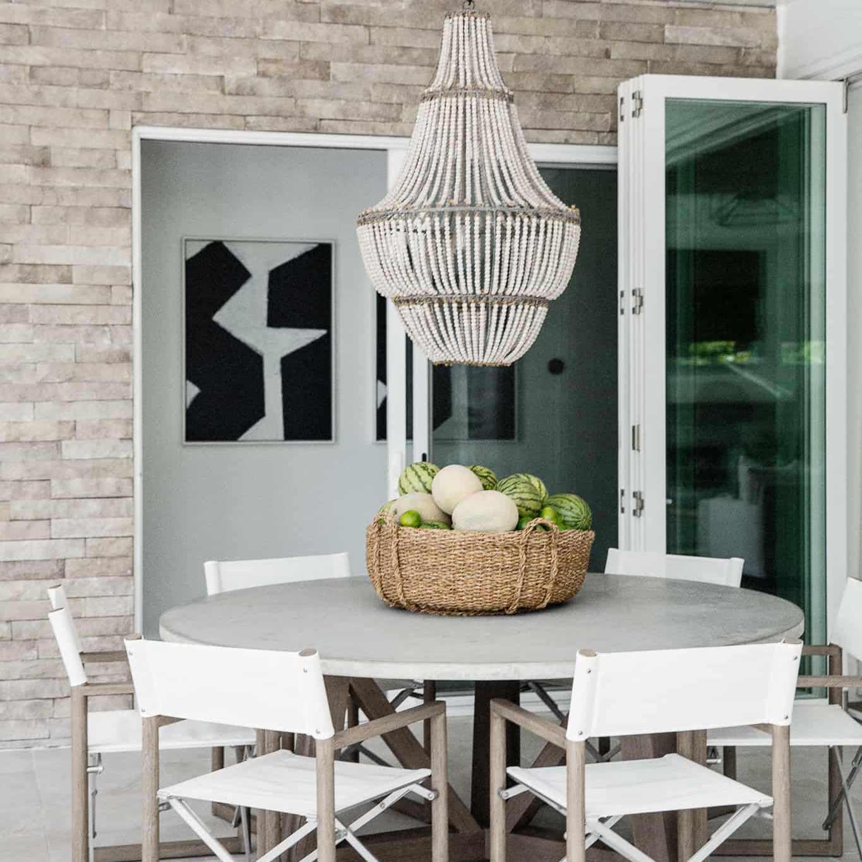 Outdoor patio set with chandelier.