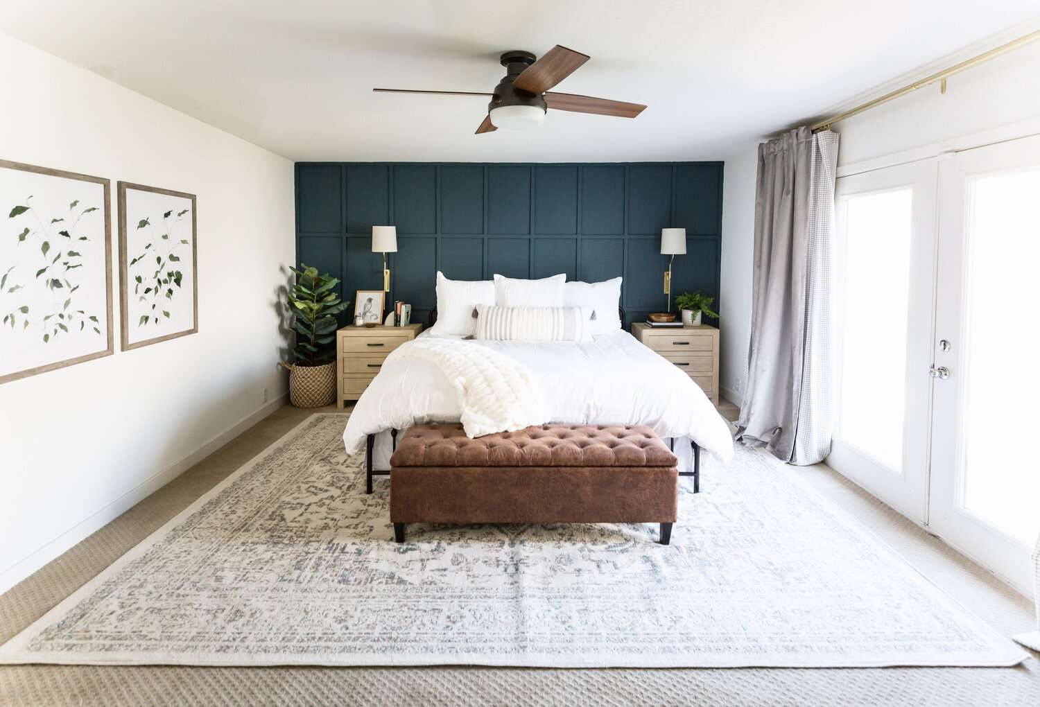 Classic neutral bedroom with navy accent wall.