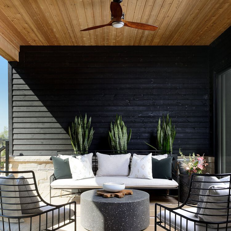 Outdoor patio space with ceiling fan.