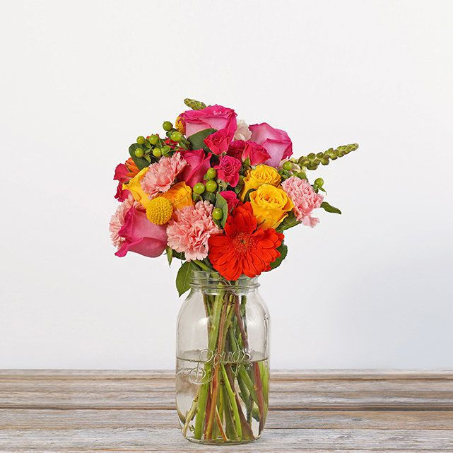 pink and yellow bouquet in a mason jar