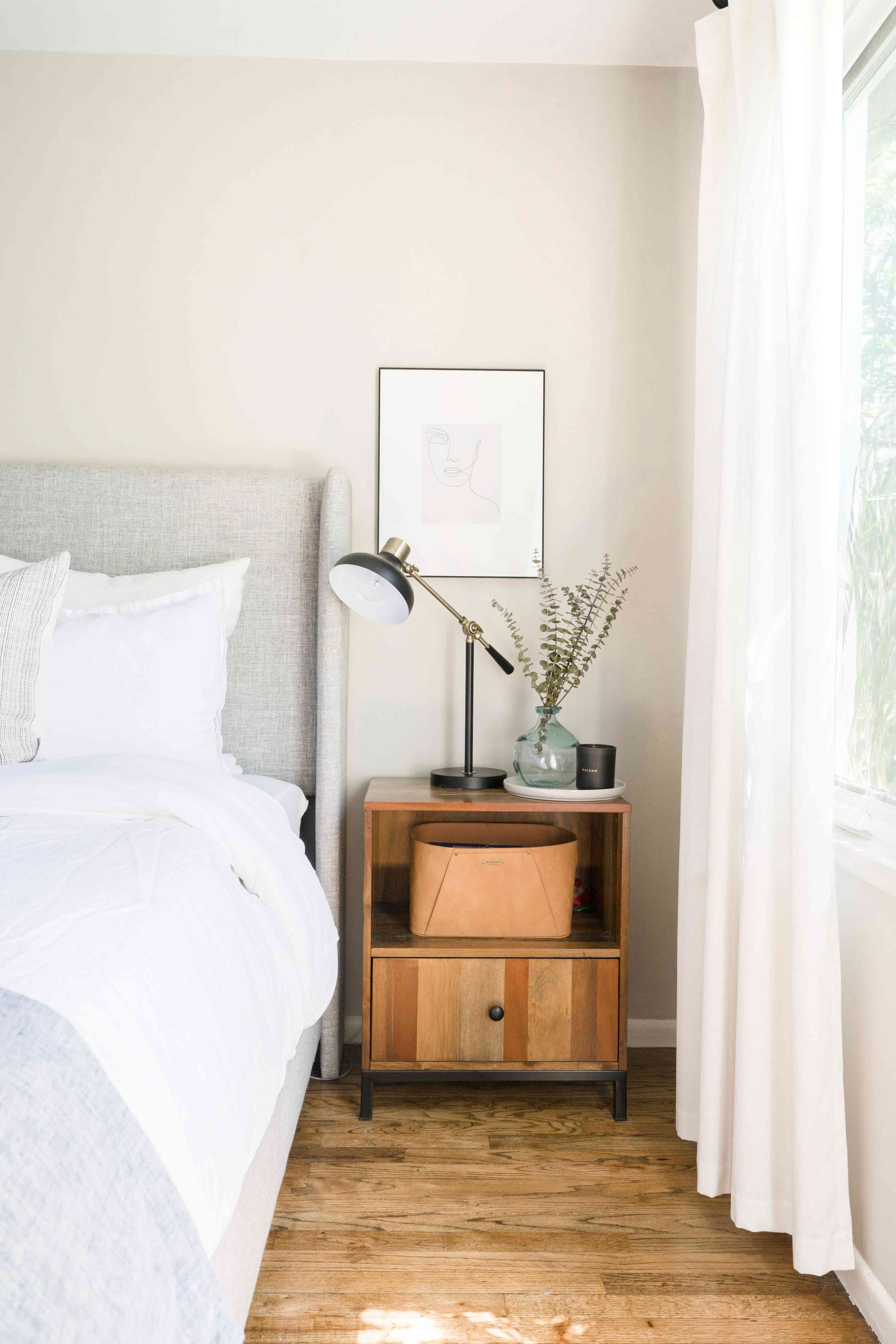 alisha agrellas home tour - bedroom with gray bed and neutral palette