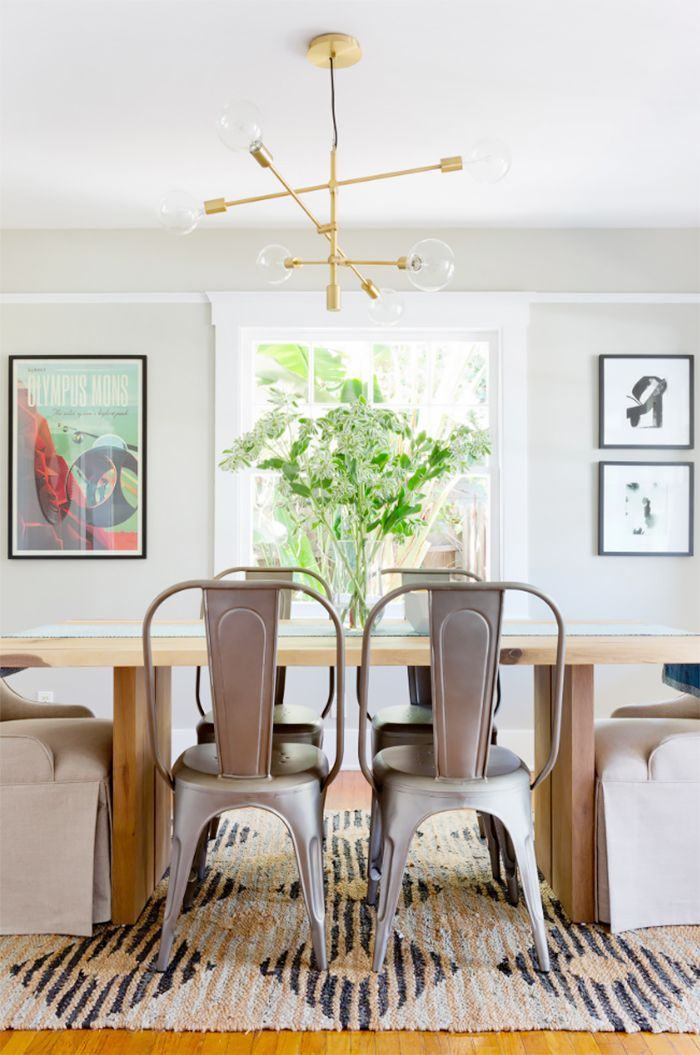 Dining room with asymmetrical art display