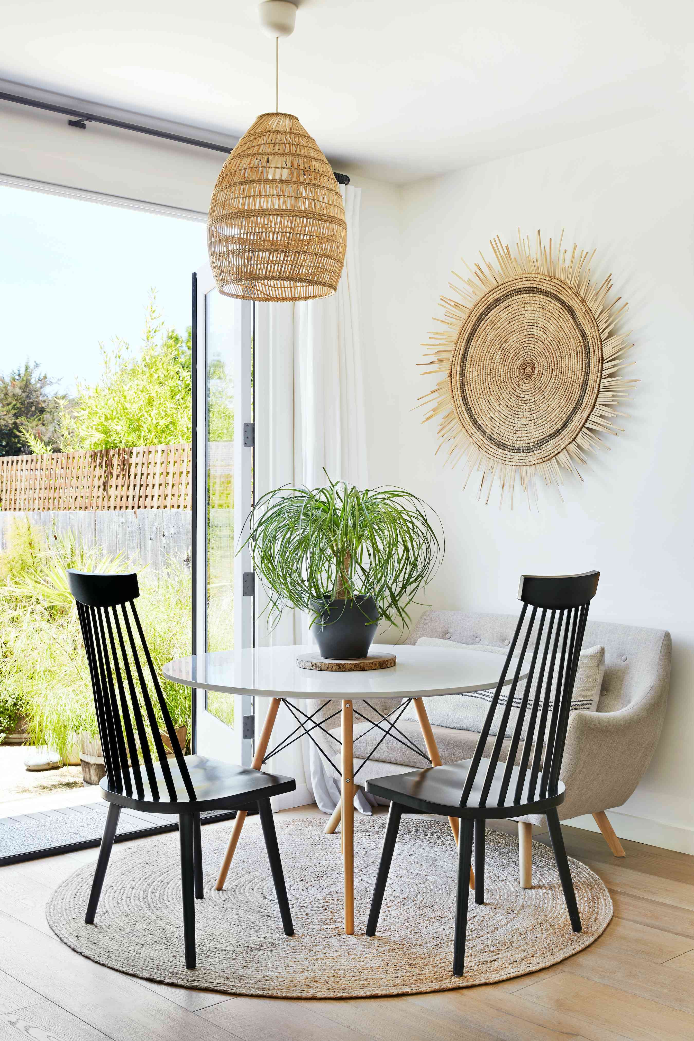 Sunny dining room with ponytail palm.