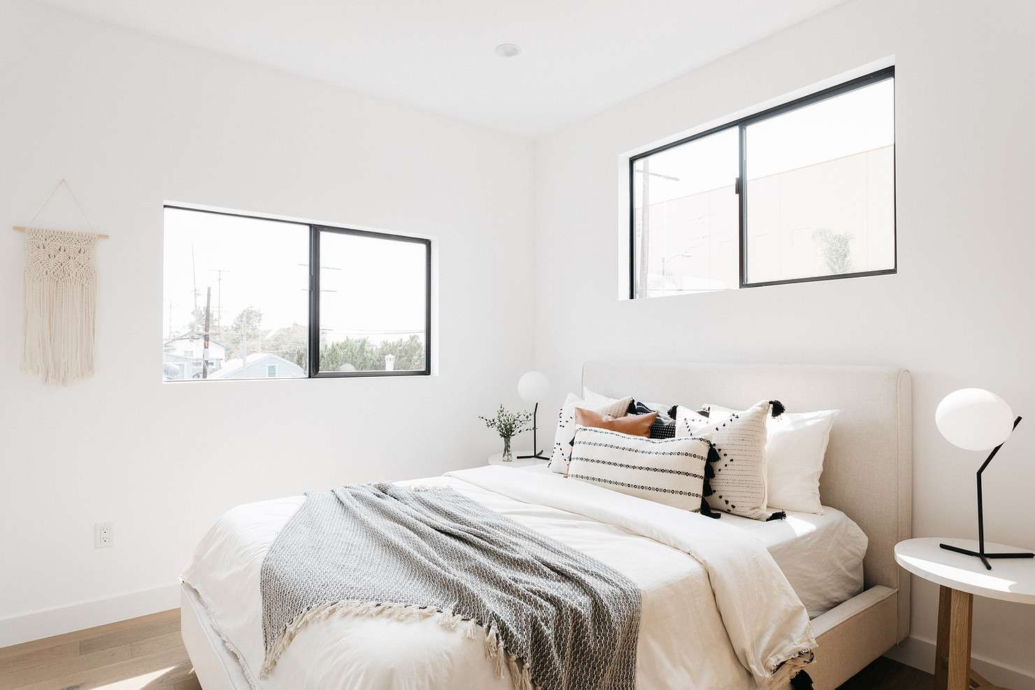 Small bedroom with bright windows