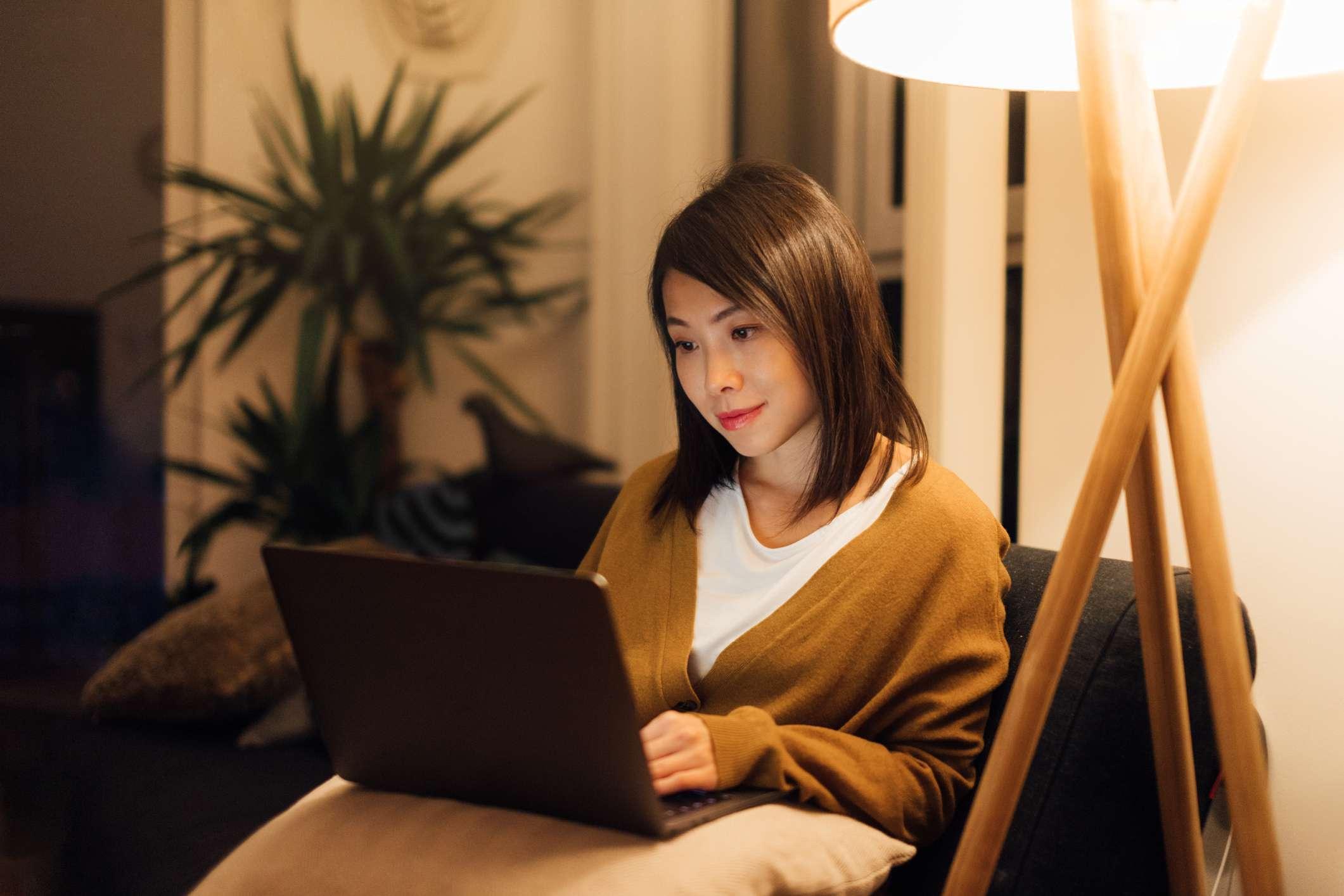 Woman focused on laptop screen