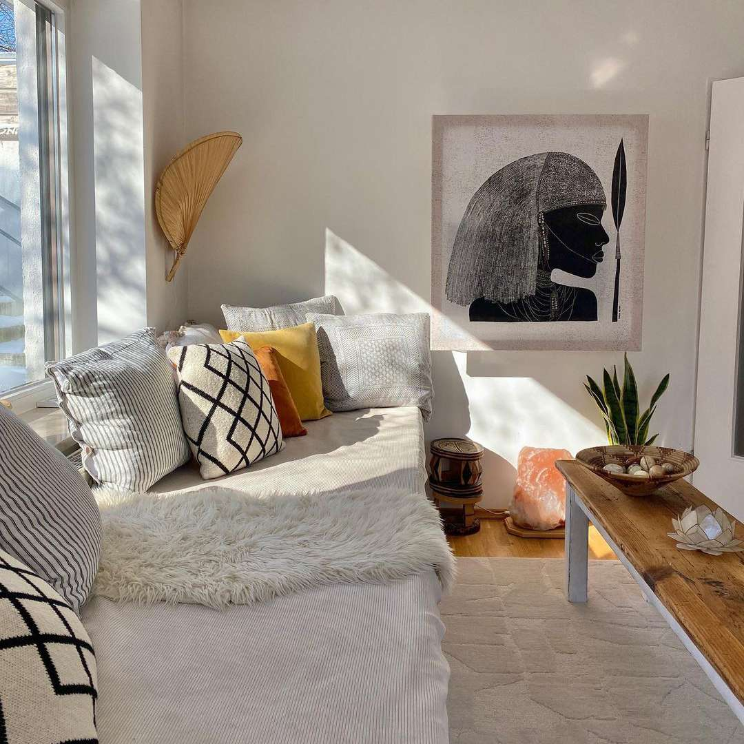 Living space with African wall art.