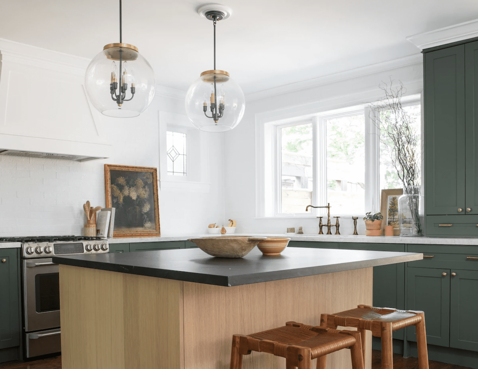 A green kitchen with an overhang bar
