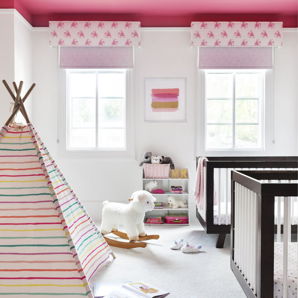 Bedroom with pink ceiling