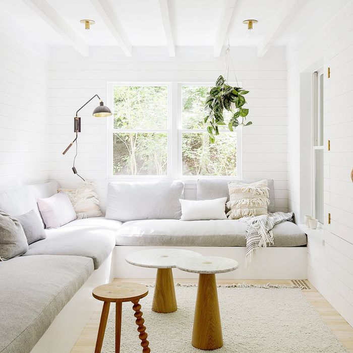 a living room with a built-in sectional sofa