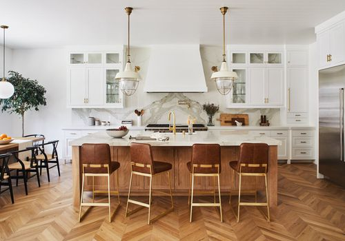 A contemporary kitchen with zigzag hardwood floors.
