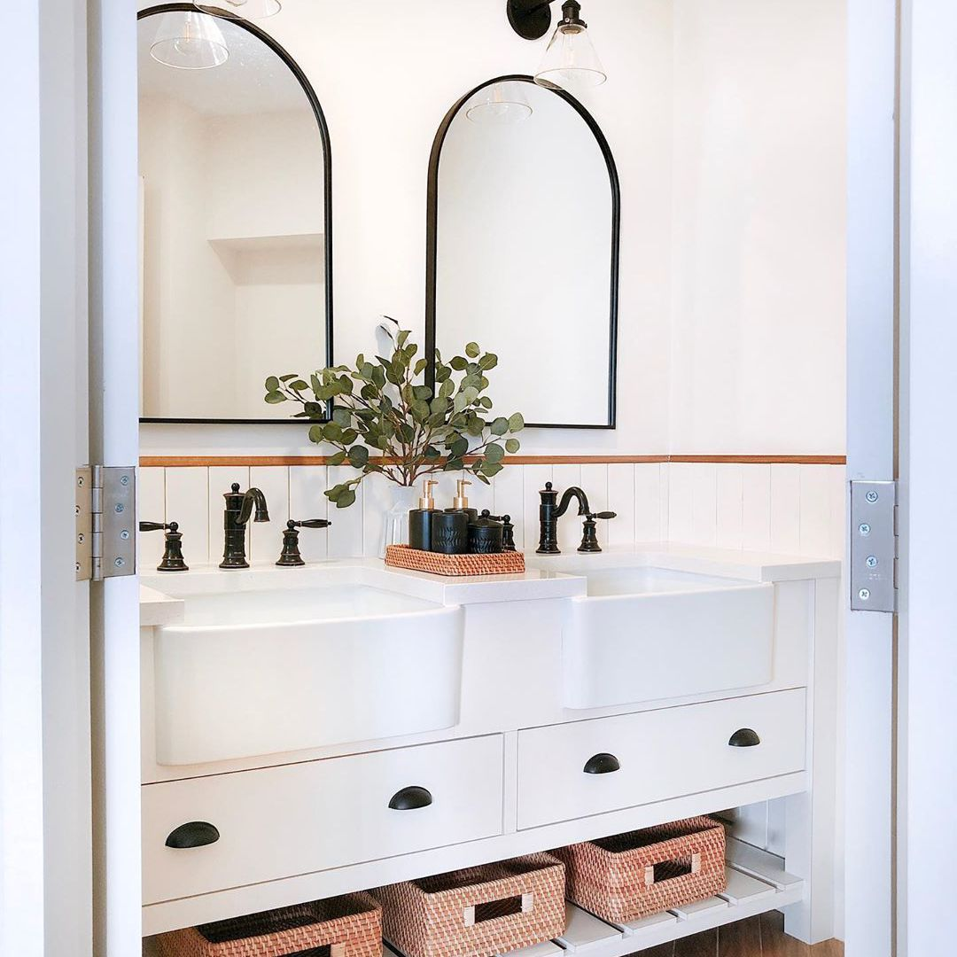 A powder room with two sinks in it