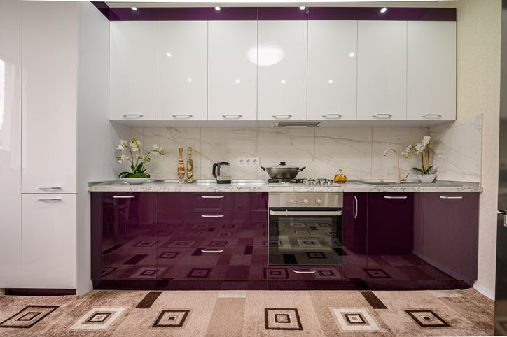 Purple and white modern kitchen furniture, front view