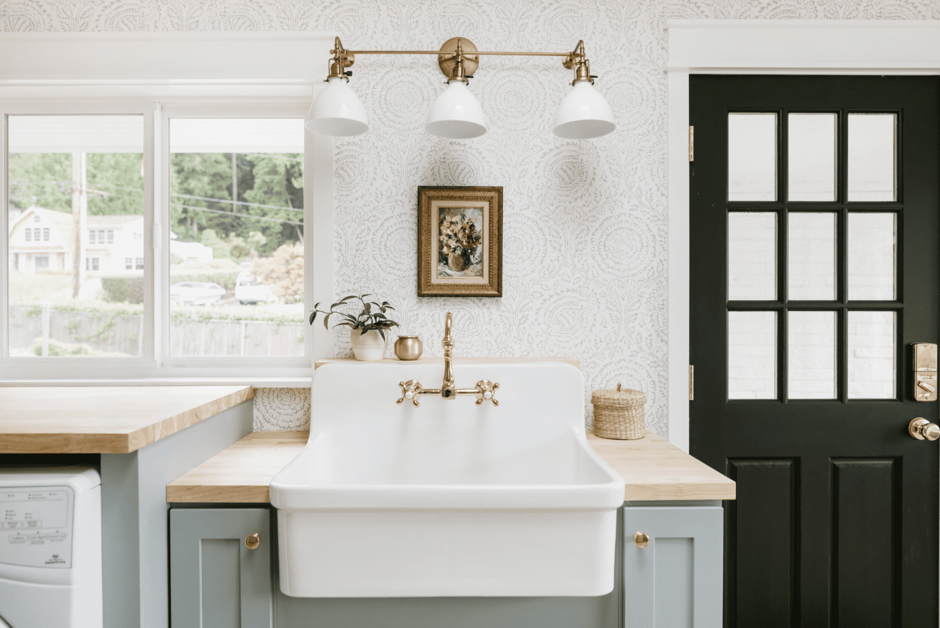 A kitchen lined with subtly printed wallpaper