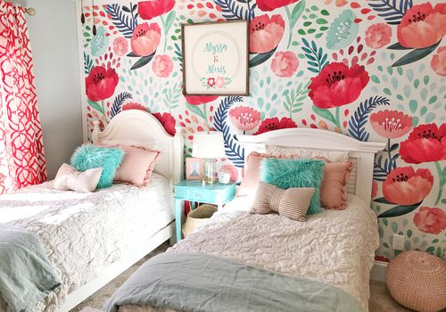 Bold and colorful girl's bedroom with floral wallpaper.