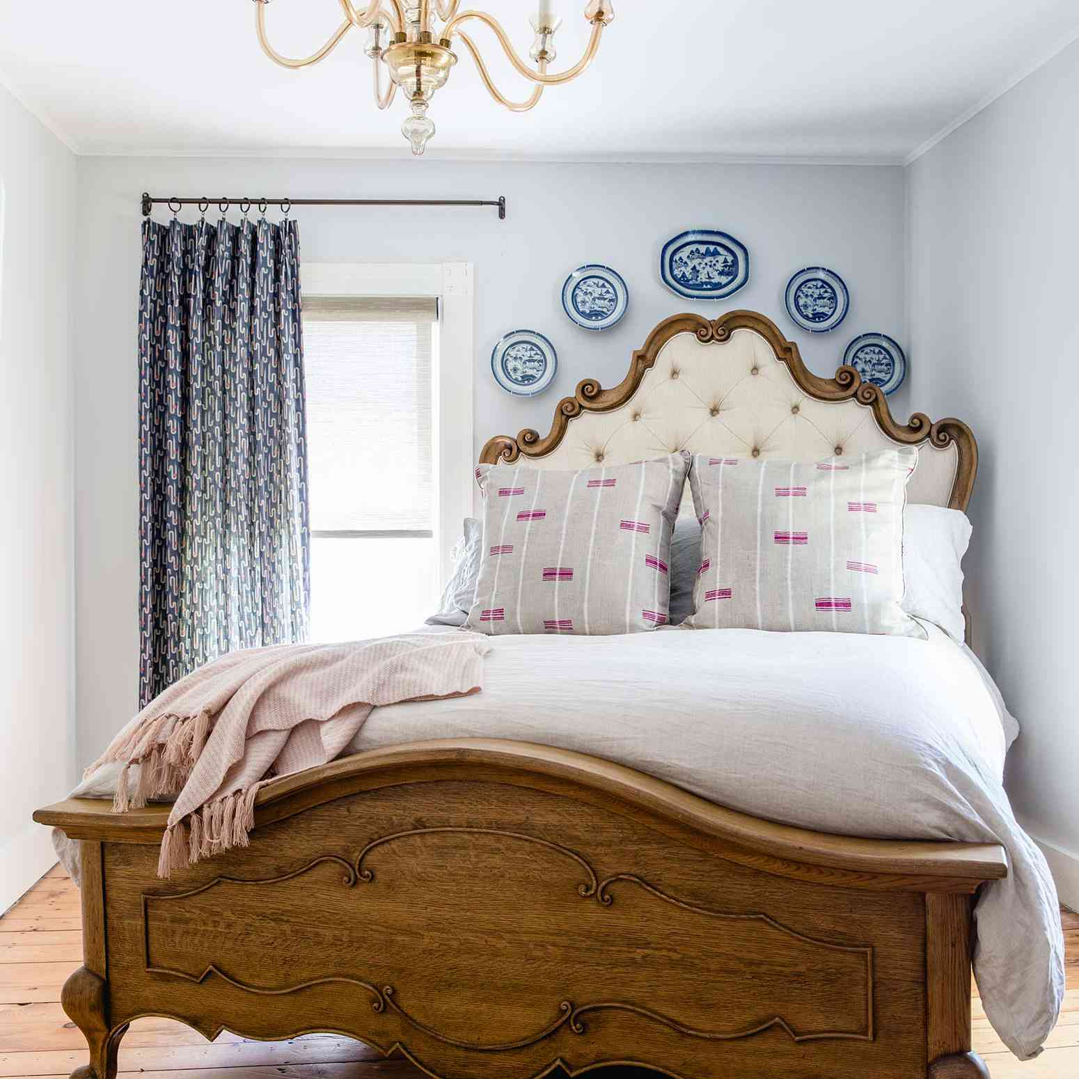A Victorian bedroom filled with contemporary prints and textiles
