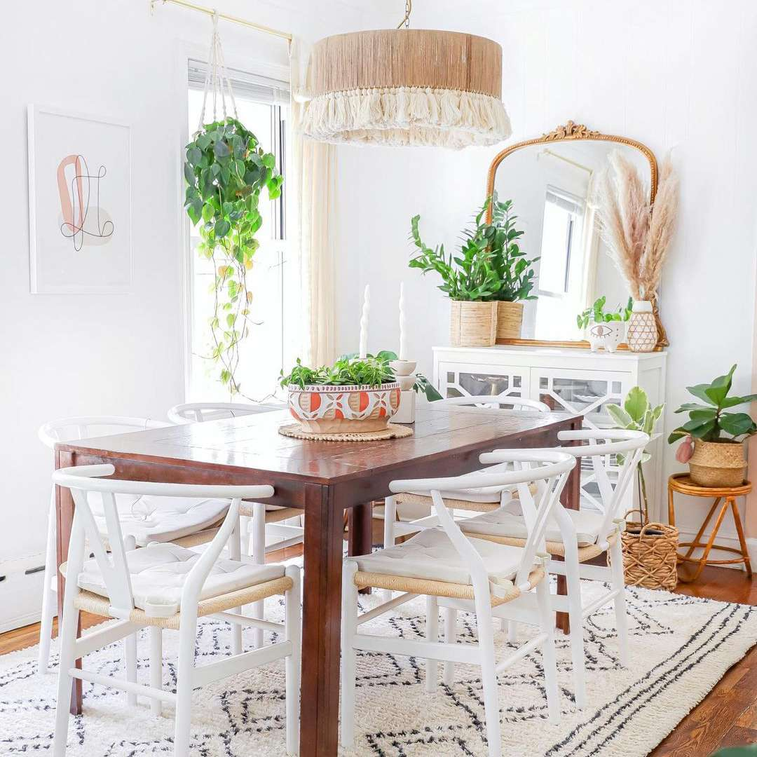 Dining room with plants and boho chandelier.