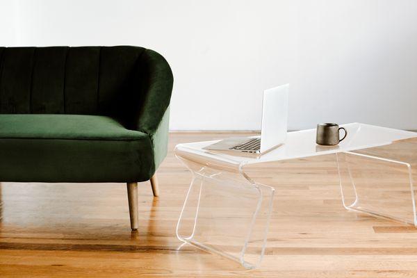 Green velvet sofa and lucite table.