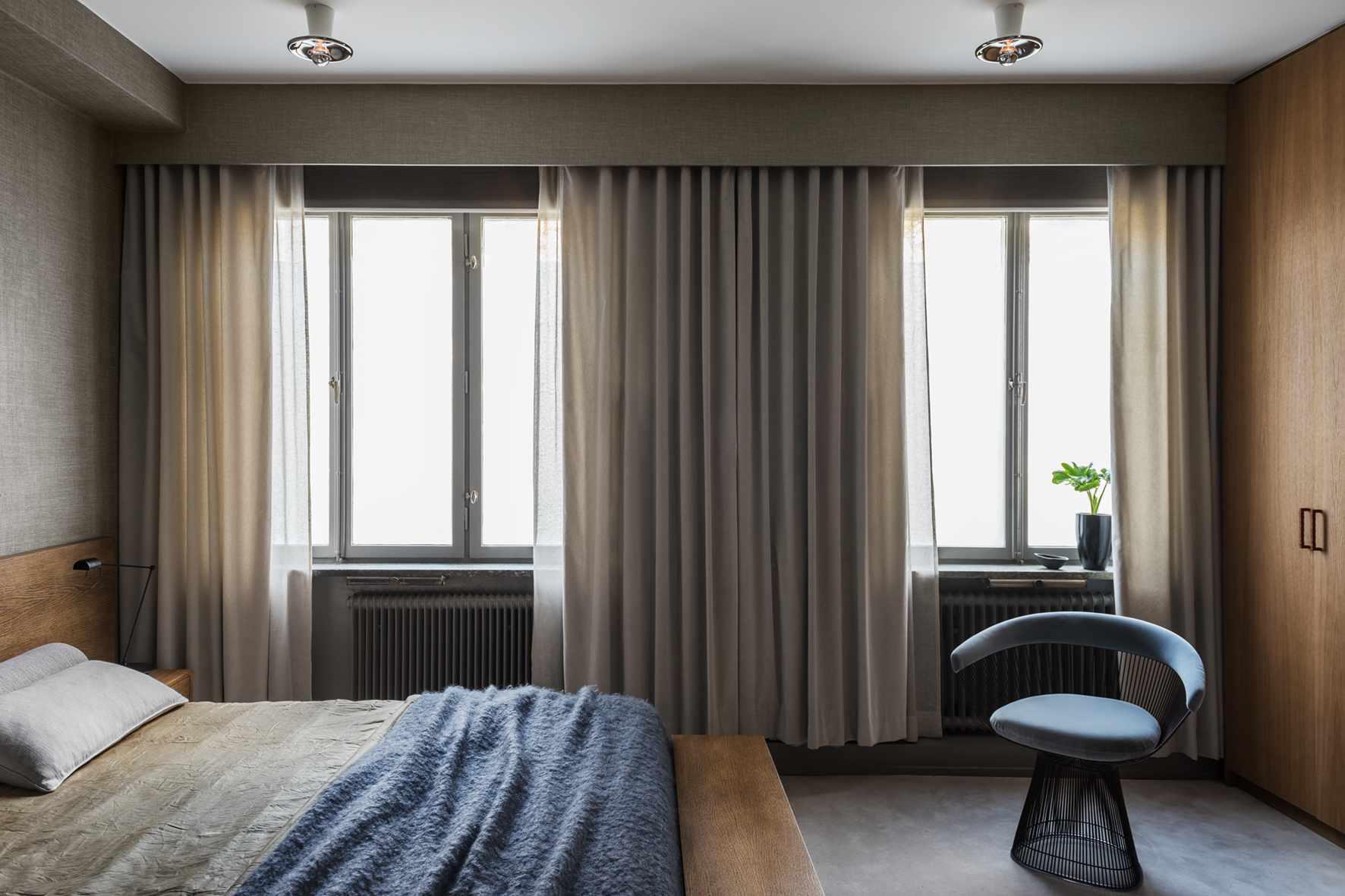Sleek modern bedroom with minimal overhead lights