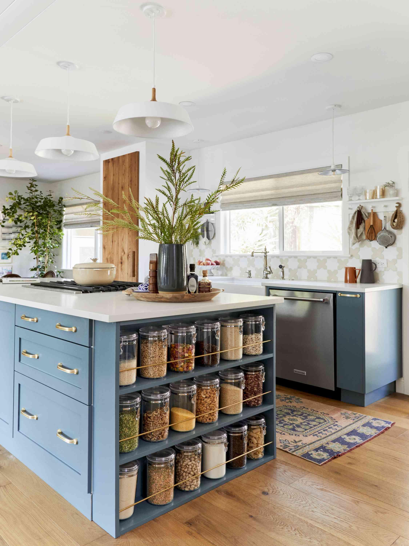 Kitchen island with storage rack for spice jars.