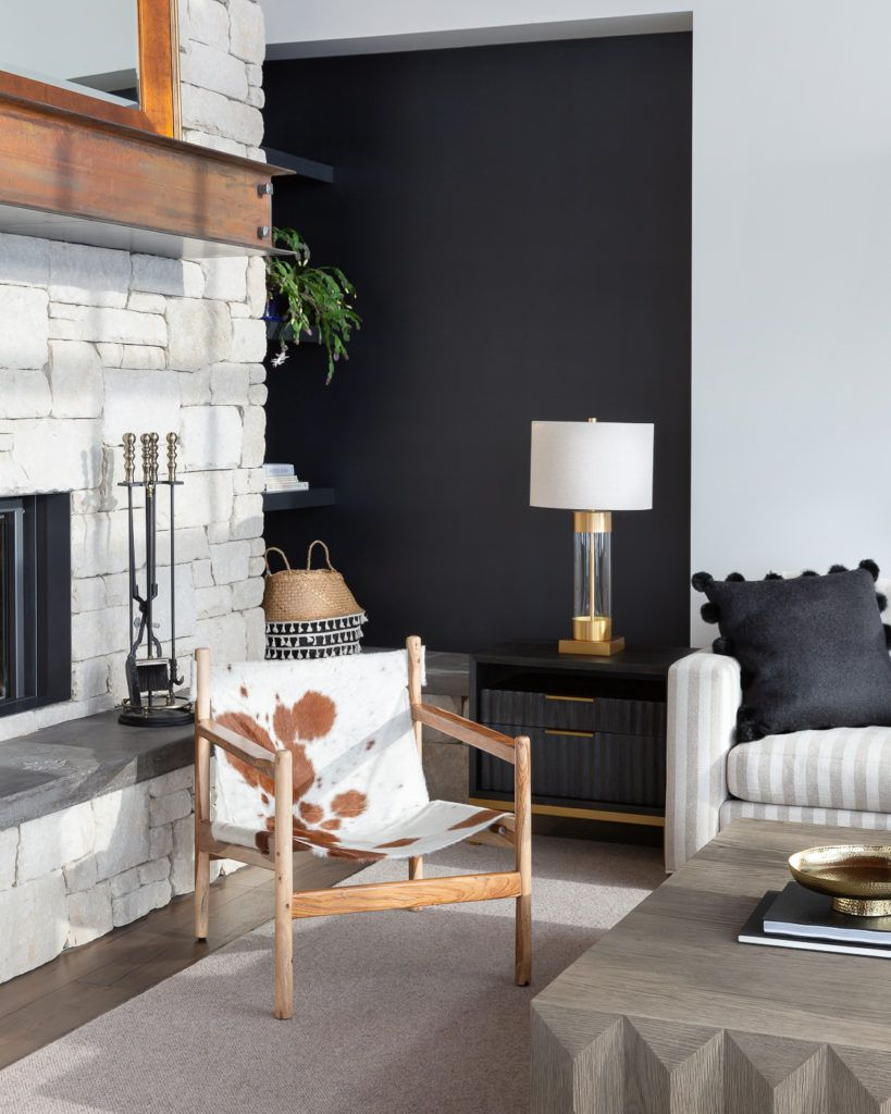 A living room with a black accent wall