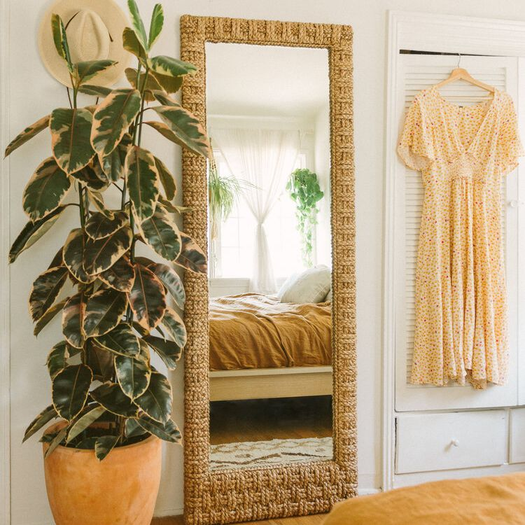 floor mirror in cozy boho bedroom
