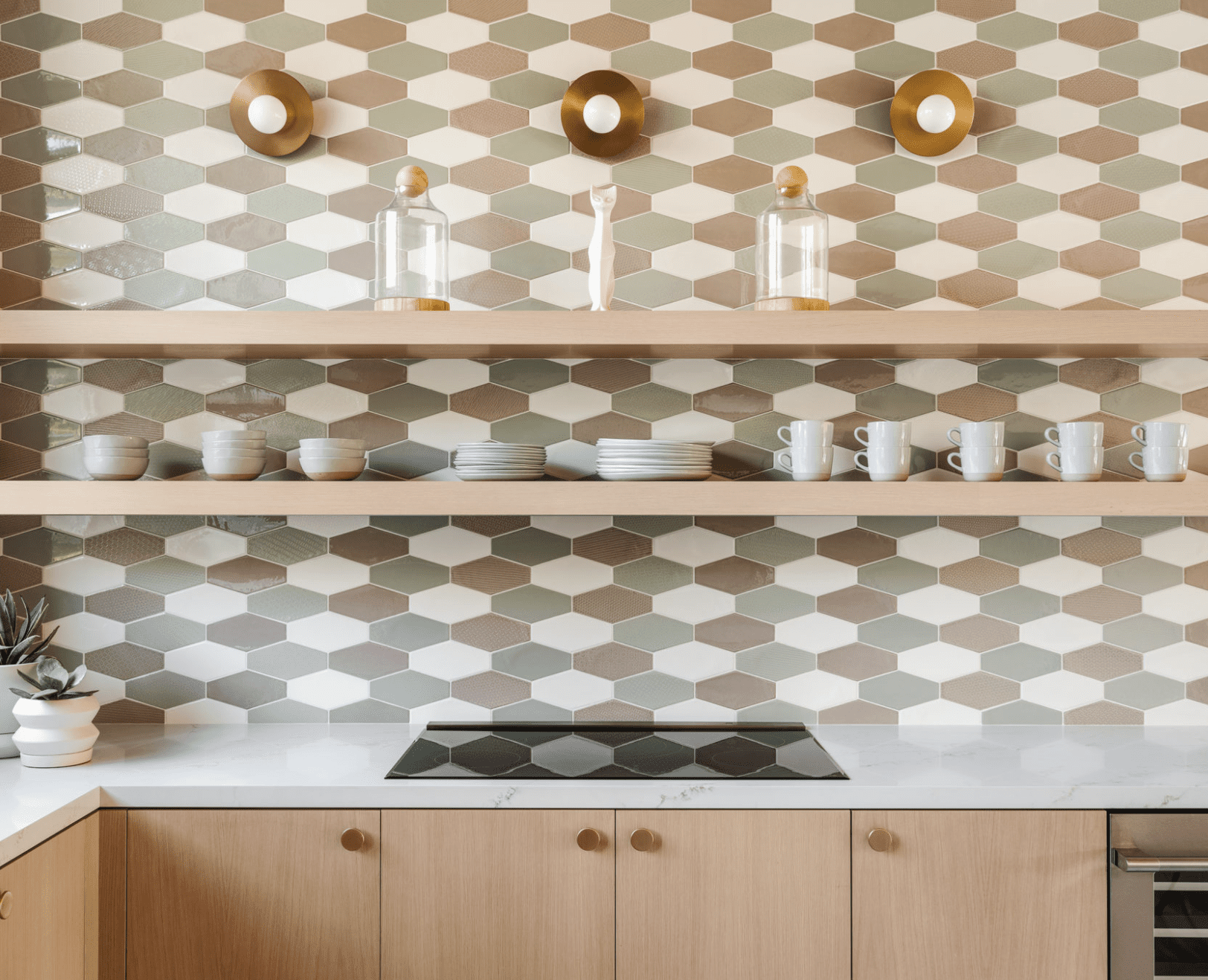A multicolored backsplash, crafted using the same tile in different colors
