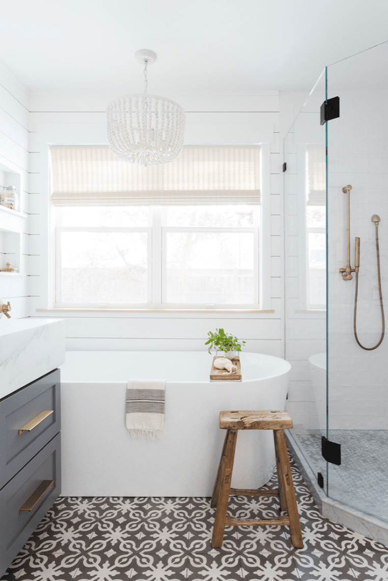 A small primary bathroom with a vanity, a bathtub, and a shower all tucked next to each other