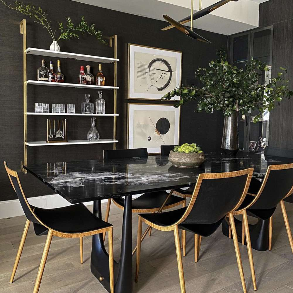 Contemporary black dining room with modern art and open shelving