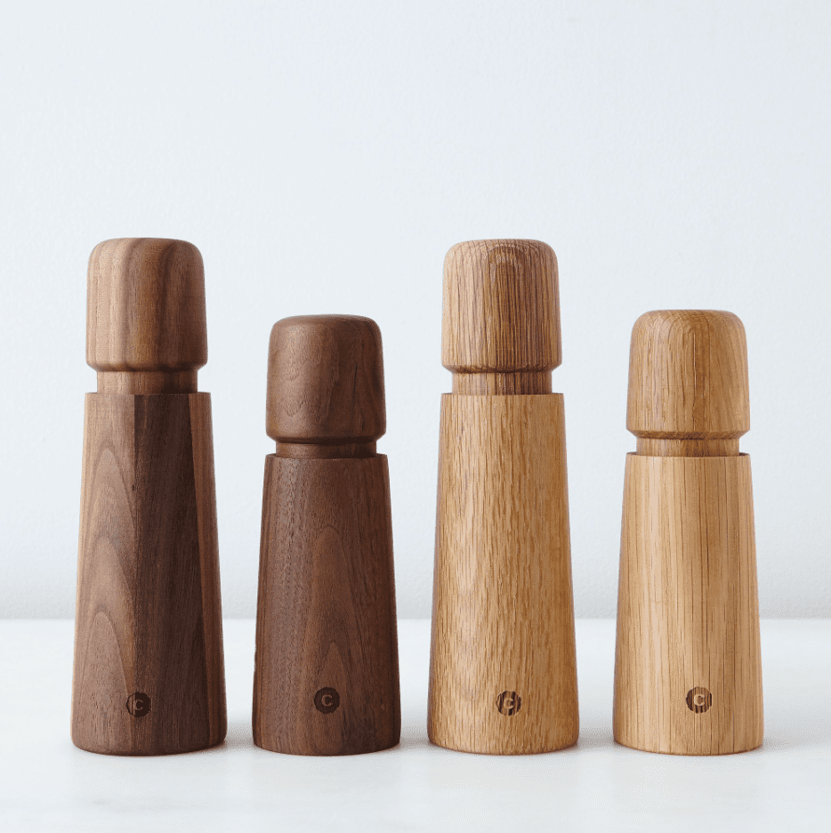 Two sets of wooden salt and pepper grinders