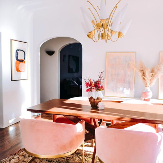 California-boho-glam dining room with blush pink velvet chairs
